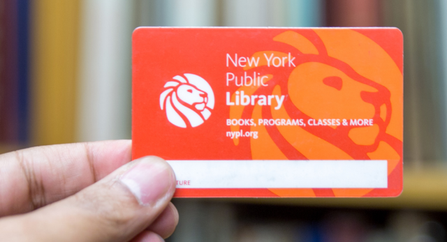Hand holding New York Public Library card