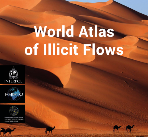 Cover: World Atlas of Illicit Flows, set against a background of sand dunes and camels