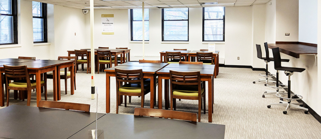 Bright room filled with desks and chairs