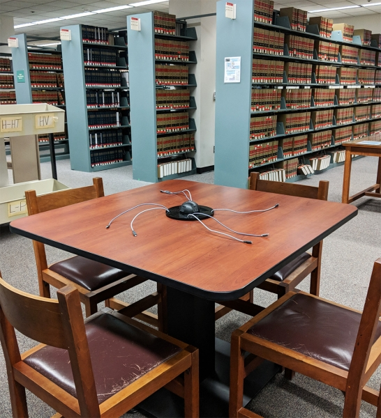 Charging table, 4 chairs, near books