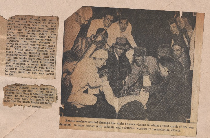 Newspaper articles including photo of fire victims being tended to