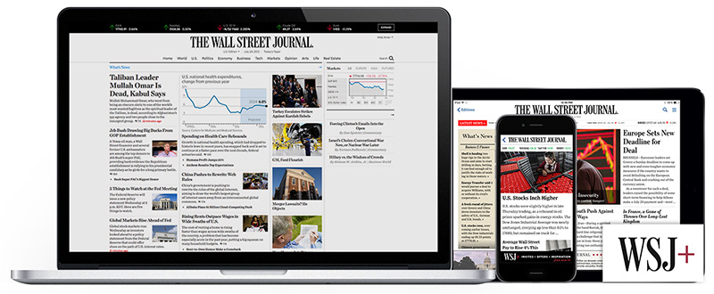 Computers and phone showing WSJ newspaper